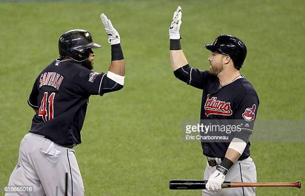 Carlos Santana of the Cleveland Indians celebrates with teammate Jason Kipnis after hitting a solo home run in the third inning against Marco Estrada...