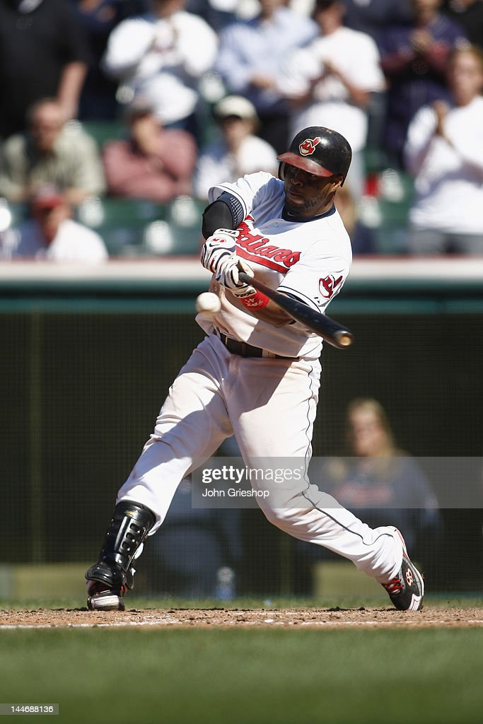 Carlos Santana #41 of the Cleveland Indians connects for a game winning r.b.i. single during the game against the Seattle Mariners at Progressive Field on May 17, 2012 in Cleveland, Ohio. The Indians defeated the Mariners 6-5.
