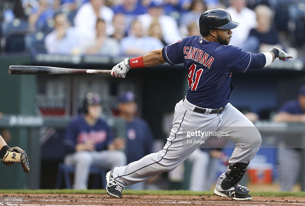 Carlos Santana #41 of the Cleveland Indians hits a RBI single in the first inning during game two of a doubleheader against the Kansas City Royals at Kauffman Stadium on April 28, 2013 in Kansas City, Missouri.