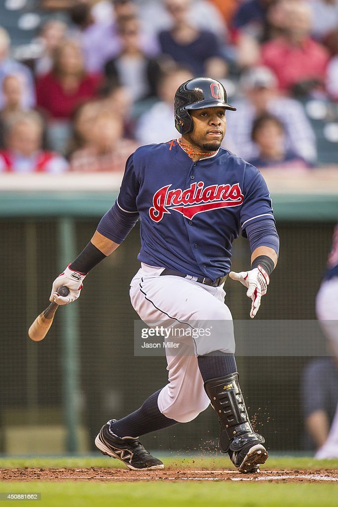 Carlos Santana #41 of the Cleveland Indians hits a single in the second inning during the game against the Detroit Tigers at Progressive Field on May 20, 2014 in Cleveland, Ohio.