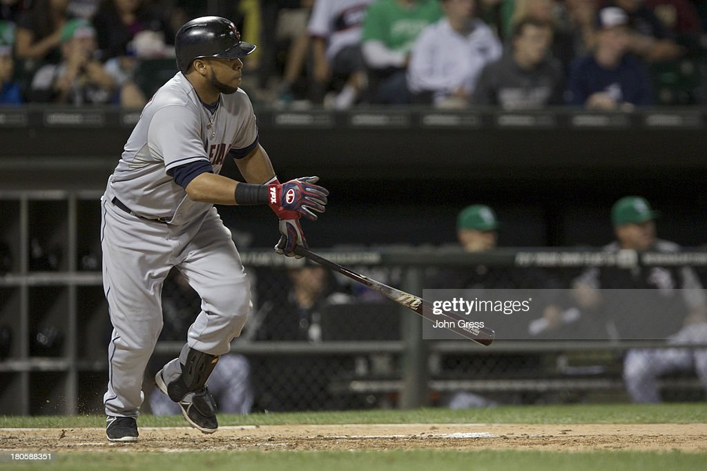 Carlos Santana #41 of the Cleveland Indians hits a two RBI single off of the Chicago White Sox during the sixth inning of their MLB game at U.S. Cellular Field on September 14, 2013 in Chicago, Illinois.