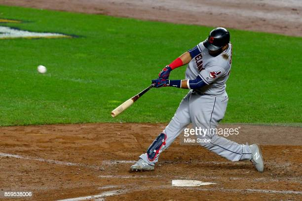 Carlos Santana of the Cleveland Indians hits a two run home run scoring Jay Bruce against Luis Severino of the New York Yankees during the fourth...