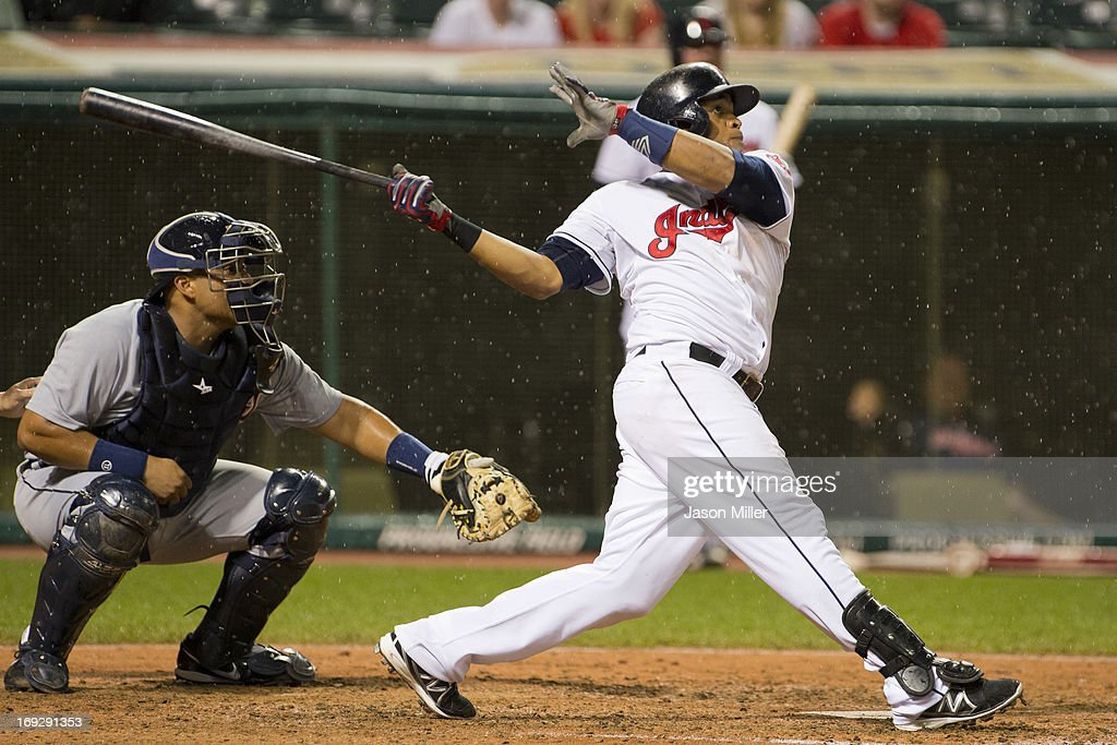 Carlos Santana #41 of the Cleveland Indians hits a two run home run during the fifth inning against the Detroit Tigers at Progressive Field on May 22, 2013 in Cleveland, Ohio.