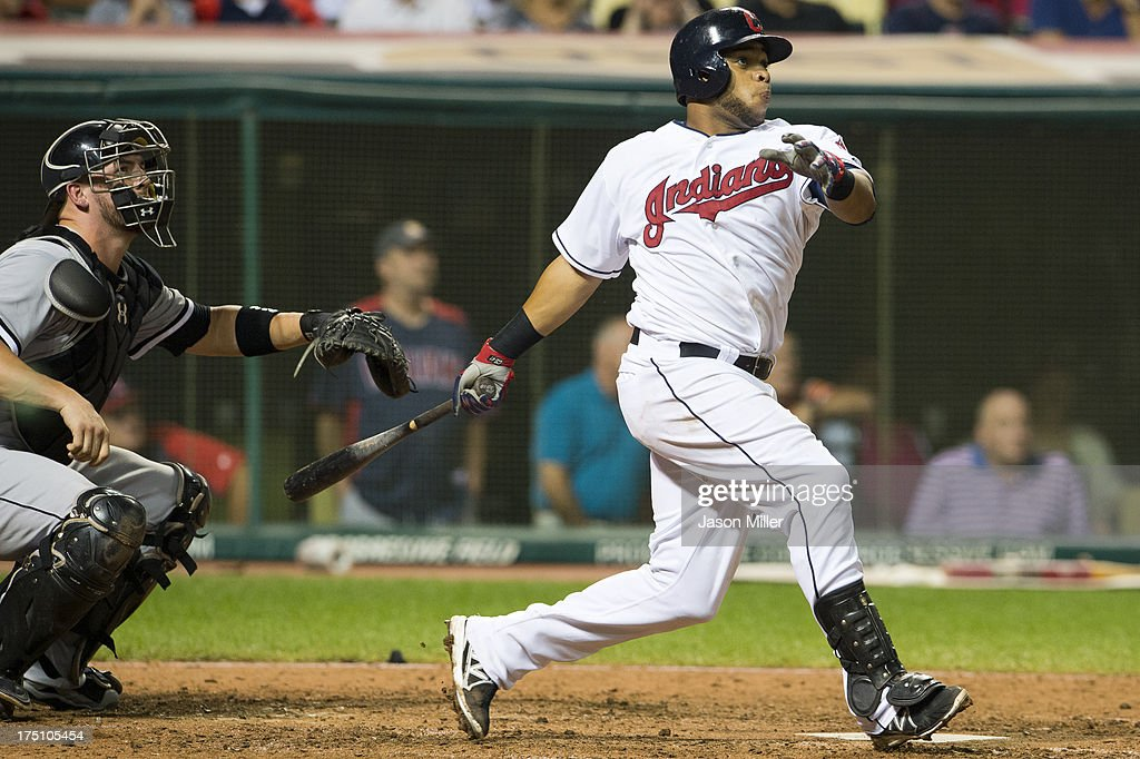 Carlos Santana #41 of the Cleveland Indians hits a walk-off solo home run during the tenth inning against the Chicago White Sox at Progressive Field on July 31, 2013 in Cleveland, Ohio.