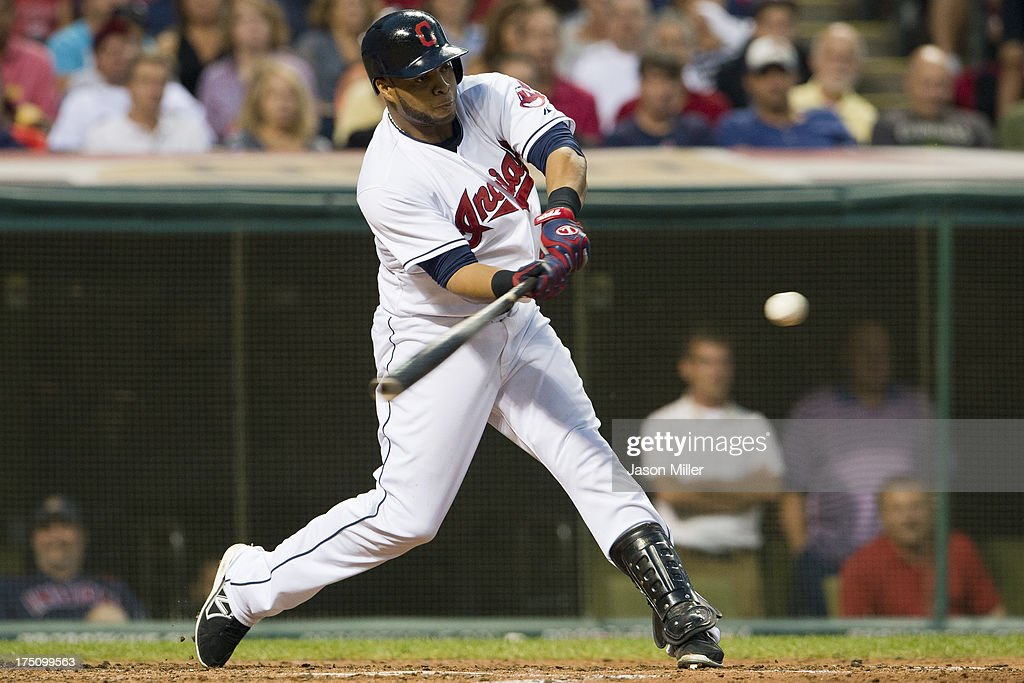 Carlos Santana #41 of the Cleveland Indians hits an RBI double during the fifth inning against the Chicago White Sox at Progressive Field on July 31, 2013 in Cleveland, Ohio.