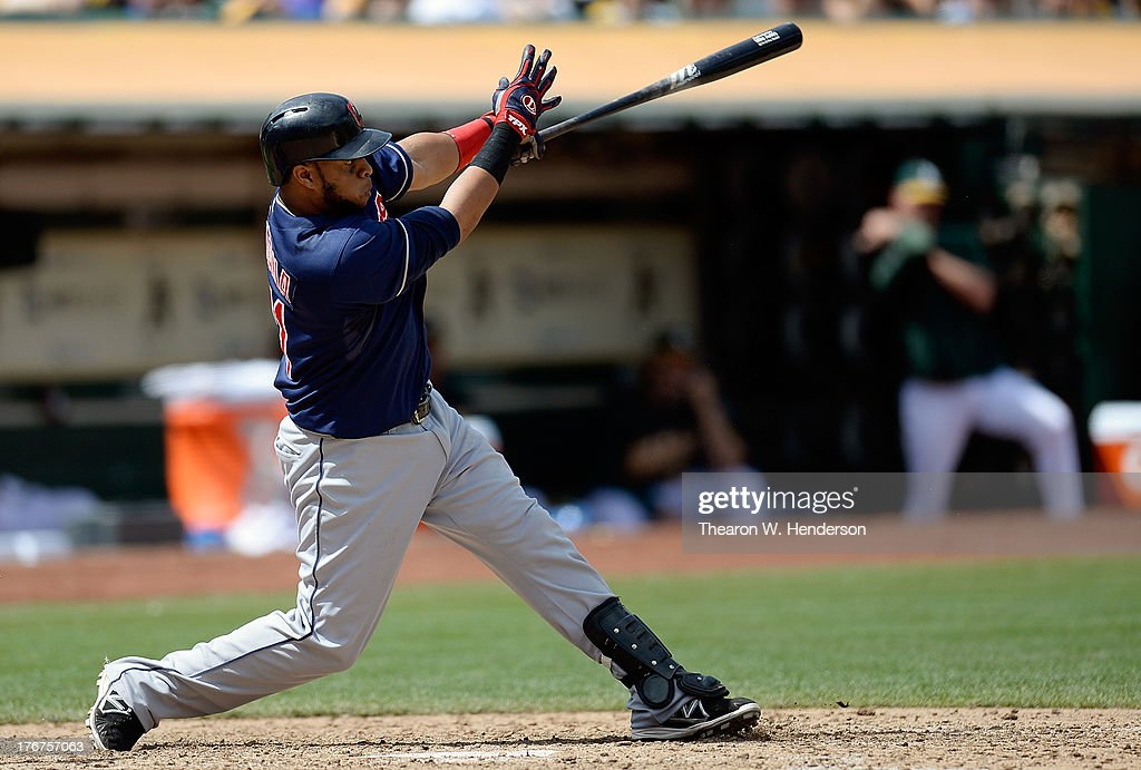 Carlos Santana #41 of the Cleveland Indians hits an RBI double scoring Jason Kipnis #22 in the fifth inning against the Oakland Athletics at O.co Coliseum on August 18, 2013 in Oakland, California.