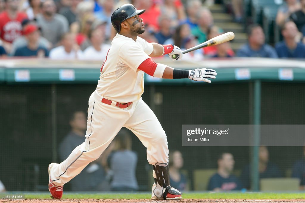 Carlos Santana #41 of the Cleveland Indians hits an RBI double to center during the first inning against the Detroit Tigers a Progressive Field on September 1, 2014 in Cleveland, Ohio.