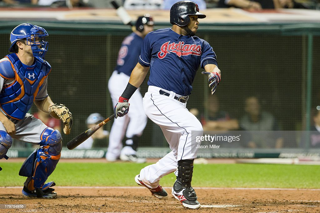 Carlos Santana #41 of the Cleveland Indians hits an RBI single during the fifth inning against the New York Mets at Progressive Field on September 6, 2013 in Cleveland, Ohio.