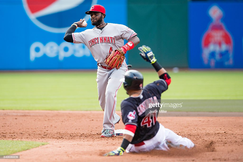 <a gi-track='captionPersonalityLinkClicked' href=/galleries/search?phrase=Carlos+Santana+-+Baseball+Player&family=editorial&specificpeople=11497843 ng-click='$event.stopPropagation()'>Carlos Santana</a> #41 of the Cleveland Indians is out at second as second baseman <a gi-track='captionPersonalityLinkClicked' href=/galleries/search?phrase=Brandon+Phillips+-+Baseball+Player&family=editorial&specificpeople=538206 ng-click='$event.stopPropagation()'>Brandon Phillips</a> #4 of the Cincinnati Reds throws out Jose Ramirez #11 of the Cleveland Indians at first to end the second inning at Progressive Field on May 16, 2016 in Cleveland, Ohio.