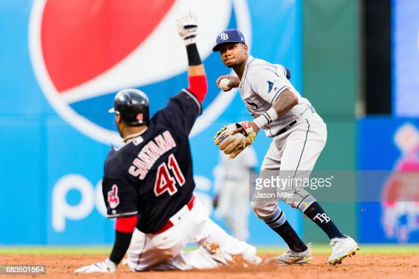 Carlos Santana of the Cleveland Indians is out at second as shortstop Tim Beckham of the Tampa Bay Rays throws to first on a ground ball off the bat...