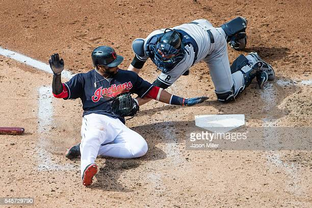 Carlos Santana of the Cleveland Indians is tagged out by catcher Brian McCann of the New York Yankees during the third inning at Progressive Field on...