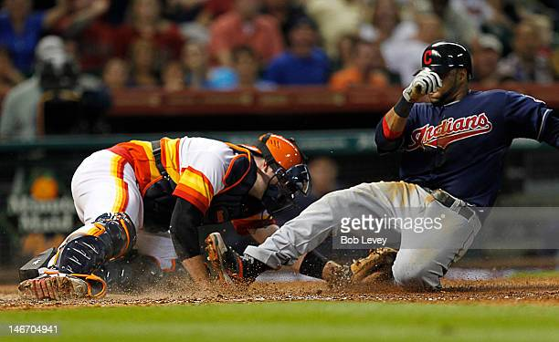 Carlos Santana of the Cleveland Indians is tagged out by Chris Snyder of the Houston Astros in the seventh inning at Minute Maid Park on June 22 2012...