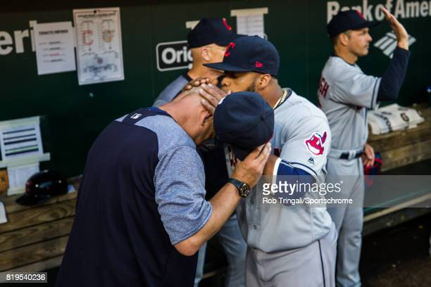 Carlos Santana of the Cleveland Indians kisses the head of manager Terry Francona before the game against the Baltimore Orioles at Oriole Park at...