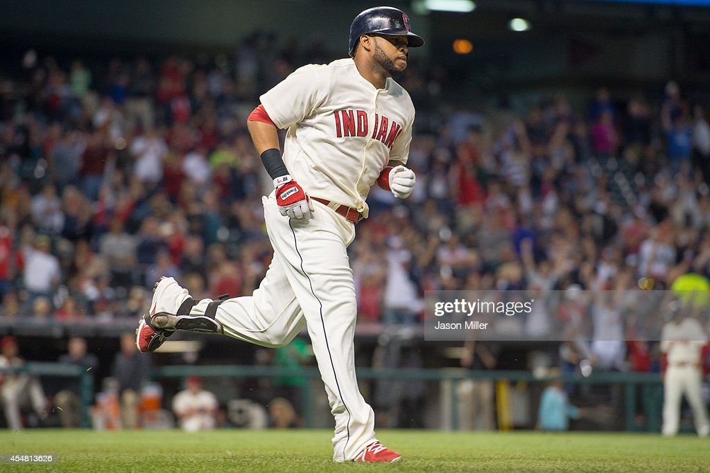 Carlos Santana #41 of the Cleveland Indians rounds the bases after hitting a solo home run during the fourth inning against the Chicago White Sox at Progressive Field on September 6, 2014 in Cleveland, Ohio.