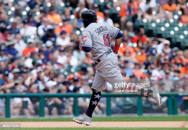 Carlos Santana of the Cleveland Indians rounds the bases after hitting a tworun home run against the Detroit Tigers during the seventh inning of game...