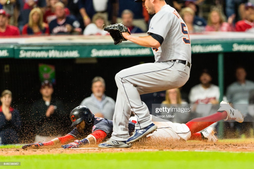 Carlos Santana #41 of the Cleveland Indians scores on a wild pitch by Drew VerHagen #54 of the Detroit Tigers during the sixth inning at Progressive Field on September 12, 2017 in Cleveland, Ohio.