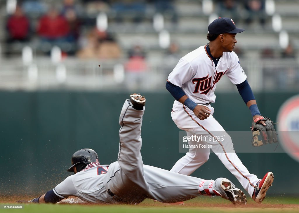 Carlos Santana #41 of the Cleveland Indians slides into second base safely with an RBI double as Jorge Polanco #11 of the Minnesota Twins fields the ball during the fifth inning of the game on April 20, 2017 at Target Field in Minneapolis, Minnesota. The Indians defeated the Twins 6-2.