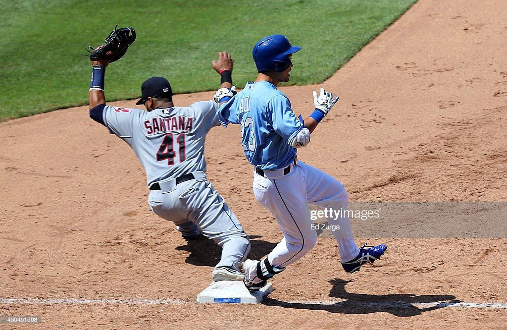 Carlos Santana #41 of the Cleveland Indians steps on first to get the out on <a gi-track='captionPersonalityLinkClicked' href=/galleries/search?phrase=Norichika+Aoki&family=editorial&specificpeople=850957 ng-click='$event.stopPropagation()'>Norichika Aoki</a> #23 of the Kansas City Royals on a ground out in the seventh inning at Kauffman Stadium on June 11, 2014 in Kansas City, Missouri.