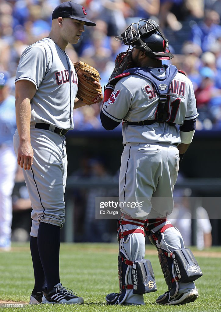Carlos Santana #41 of the Cleveland Indians talks with staring pitcher <a gi-track='captionPersonalityLinkClicked' href=/galleries/search?phrase=Justin+Masterson&family=editorial&specificpeople=4950538 ng-click='$event.stopPropagation()'>Justin Masterson</a> #63 of the Cleveland Indians in the fourth inning during game one of a doubleheader against the Kansas City Royals at Kauffman Stadium on April 28, 2013 in Kansas City, Missouri.