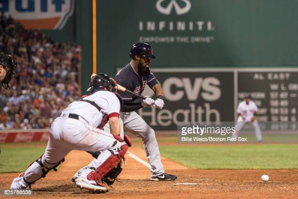 Carlos Santana of the Cleveland Indians walks on a wild pitch as the ball gets past Christian Vazquez of the Boston Red Sox during the ninth inning...