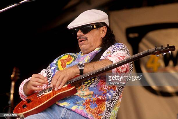 Carlos Santana performing with his band at the New Orleans Jazz Heritage Festival on April 26 1997