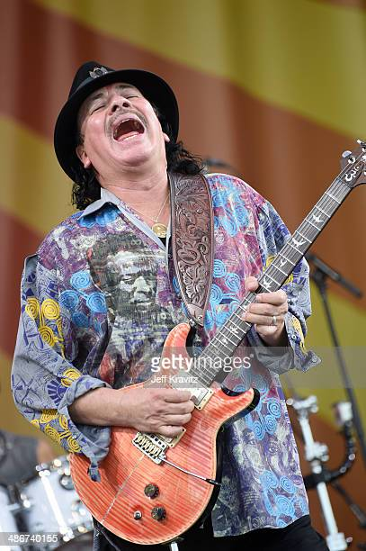 Carlos Santana performs during the 2014 New Orleans Jazz Heritage Festival at Fair Grounds Race Course on April 25 2014 in New Orleans Louisiana