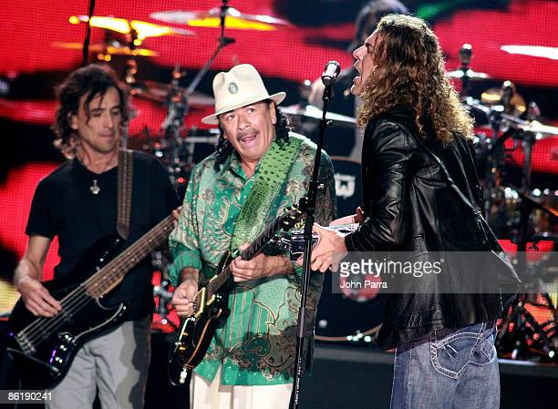 Carlos Santana performs onstage with Mana at the 2009 Billboard Latin Music Awards at Bank United Center on April 23 2009 in Miami Florida