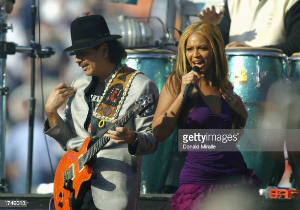 Carlos Santana performs with Beyonce Knowles of Destiny's Child before the start of Super Bowl XXXVII between the Tampa Bay Buccaneers and the...