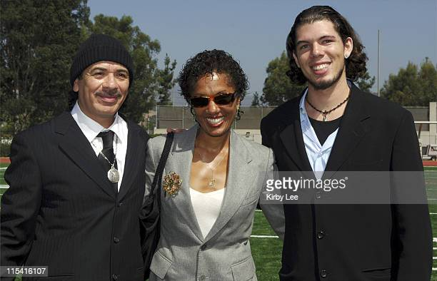 Carlos Santana poses with wife Deborah Santana and son Salvador Santana at Occidental College