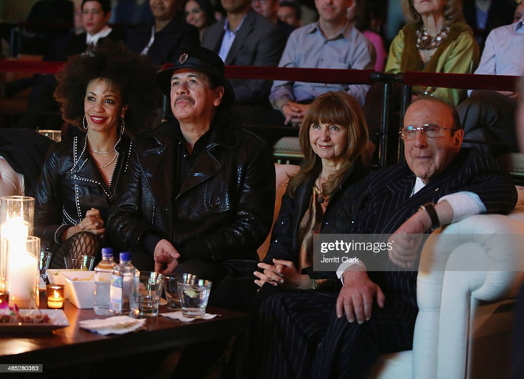 Carlos Santana, wife Cindy Blackman Santana, Lesley Glover and <a gi-track='captionPersonalityLinkClicked' href=/galleries/search?phrase=Clive+Davis&family=editorial&specificpeople=209314 ng-click='$event.stopPropagation()'>Clive Davis</a> attend the HBO Latino NYC Premiere of 'Santana: De Corazon' at Hudson Theatre on April 16, 2014 in New York City.