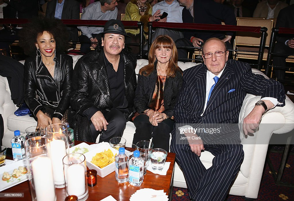 Carlos Santana, wife Cindy Blackman Santana, Lesley Glover and Clive Davis attend the HBO Latino NYC Premiere of 'Santana: De Corazon' at Hudson Theatre on April 16, 2014 in New York City.