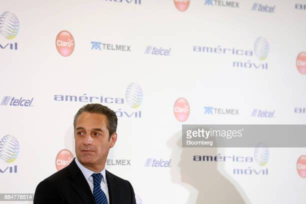 Carlos Slim Domit chairman of America Movil SAB listens during a press conference at the company's headquarters in Mexico City Mexico on Thursday May...