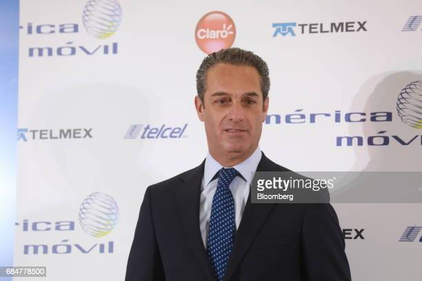 Carlos Slim Domit chairman of America Movil SAB smiles during a press conference at the company's headquarters in Mexico City Mexico on Thursday May...