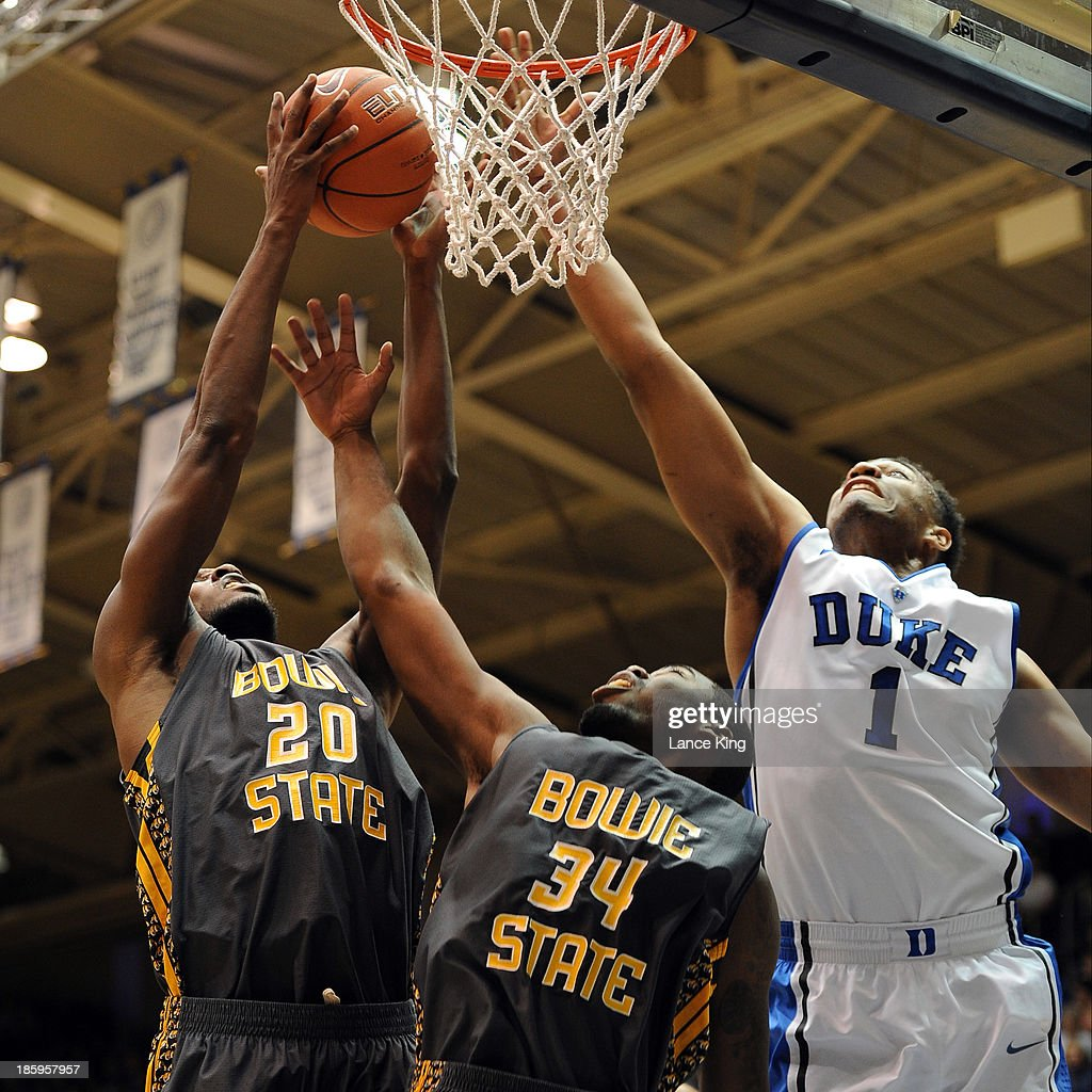 Carlos Smith #20 and Joel Clemmons #34 of the Bowie State Bulldogs go up for a rebound against <a gi-track='captionPersonalityLinkClicked' href=/galleries/search?phrase=Jabari+Parker&family=editorial&specificpeople=9330340 ng-click='$event.stopPropagation()'>Jabari Parker</a> #1 of the Duke Blue Devils at Cameron Indoor Stadium on October 26, 2013 in Durham, North Carolina.