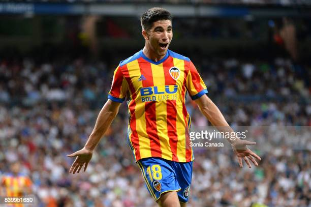 Carlos Soler #18 of Valencia CF scores a goal during the La Liga match between Real Madrid CF v Valencia at Santiago Bernabeu on August 27 2017 in...