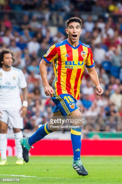 Carlos Soler Barragan of Valencia CF celebrates during their La Liga 201718 match between Real Madrid and Valencia CF at the Estadio Santiago...
