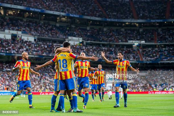 Carlos Soler Barragan of Valencia CF celebrates with teammates during their La Liga 201718 match between Real Madrid and Valencia CF at the Estadio...