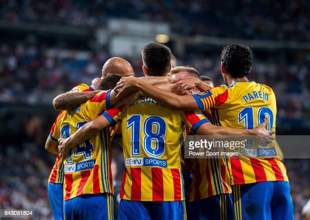 Carlos Soler Barragan of Valencia CF celebrates with teammates during their La Liga 201718 match between Real Madrid and Valencia CF at the Estadio...