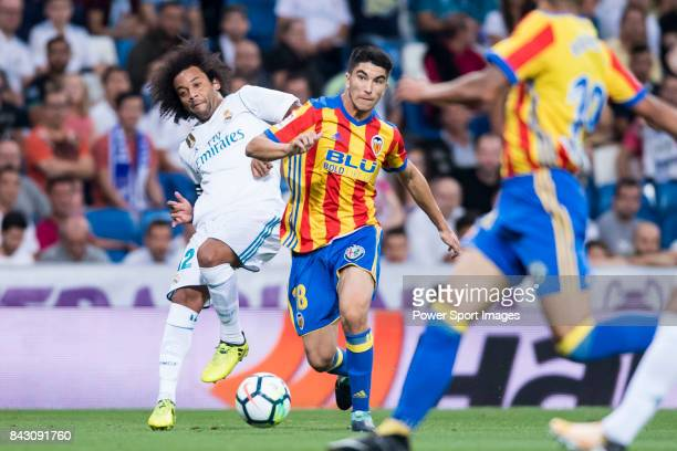 Carlos Soler Barragan of Valencia CF competes for the ball with Marcelo Vieira Da Silva of Real Madrid during their La Liga 201718 match between Real...