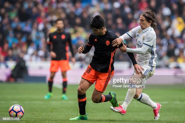 Carlos Soler Barragan of Valencia CF competes for the ball with Luka Modric of Real Madrid during their La Liga match between Real Madrid and...