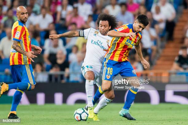 Carlos Soler Barragan of Valencia CF fights for the ball with Marcelo Vieira Da Silva of Real Madrid during their La Liga 201718 match between Real...