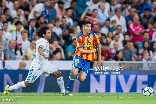Carlos Soler Barragan of Valencia CF is tackled by Marcelo Vieira Da Silva of Real Madrid during their La Liga 201718 match between Real Madrid and...
