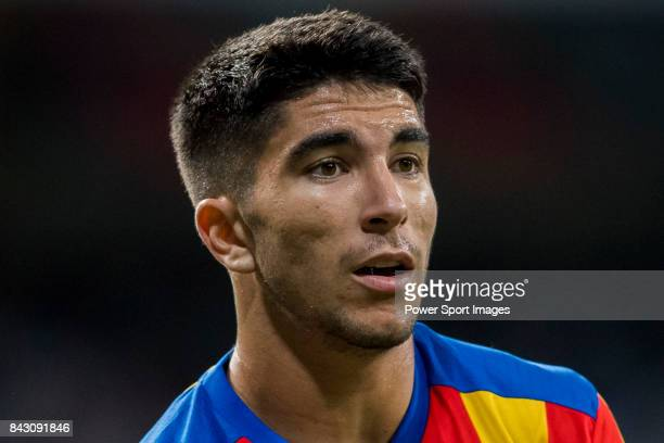 Carlos Soler Barragan of Valencia CF reacts during their La Liga 201718 match between Real Madrid and Valencia CF at the Estadio Santiago Bernabeu on...