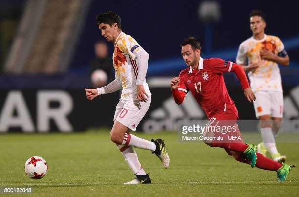Carlos Soler of Spain and Andrija Zivkovic of Serbia during their UEFA European Under21 Championship 2017 match on June 23 2017 in Bydgoszcz Poland