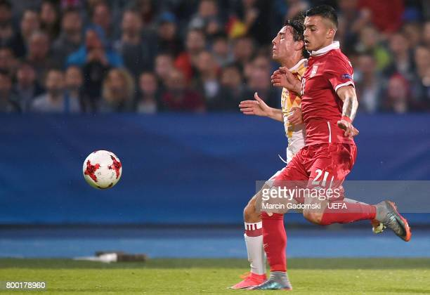 Carlos Soler of Spain and Nemanja Radonjic of Serbia during their UEFA European Under21 Championship 2017 match on June 23 2017 in Bydgoszcz Poland