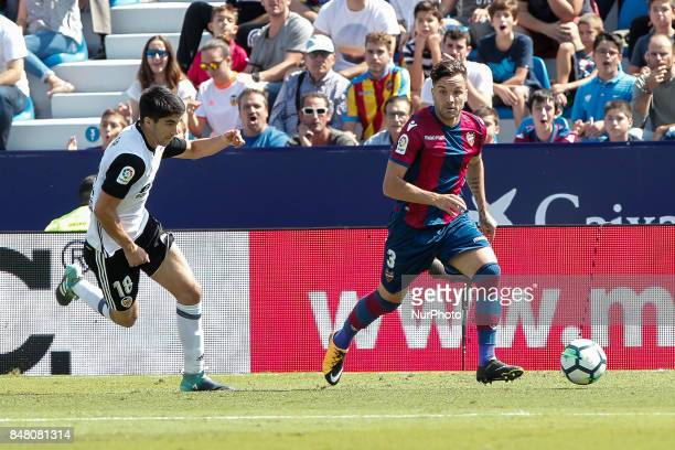 18 Carlos Soler of Valencia CF and 03 Antonio Garcia Aranda Tono of Levante Ud during spanish La Liga Santander match between Levante UD and Valencia...