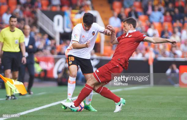 Carlos Soler of Valencia CF and Clement Lenglet of Sevilla FC during their La Liga match between Valencia CF and Sevilla FC at the Mestalla Stadium...