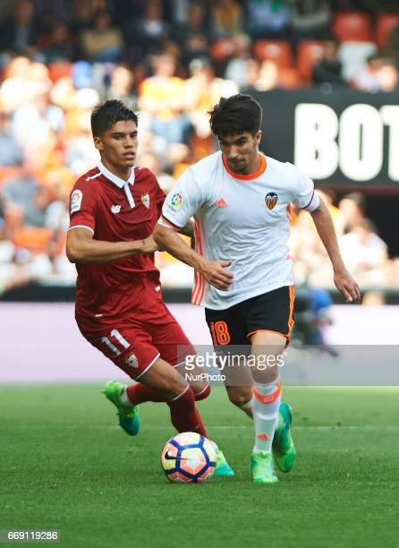 Carlos Soler of Valencia CF and Joaquin Correa of Sevilla FC during their La Liga match between Valencia CF and Sevilla FC at the Mestalla Stadium on...