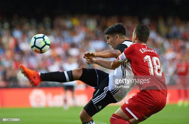 Carlos Soler of Valencia CF and Sergio Escudero of Sevilla FC in action during the La Liga match between Valencia CF and Sevilla FC at Estadio...