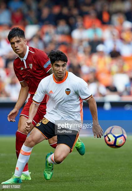 Carlos Soler of Valencia CF competes for the ball with Joaquin Correa of Sevilla FC during the La Liga match between Valencia CF and Sevilla FC at...